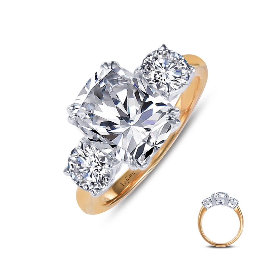 Two Tone 3 Stone Ring Features A Cushion Cut Simulated Diamond Center Stone With A Round Simulated Diamond On Each Side Set In Sterling Silver Bonded